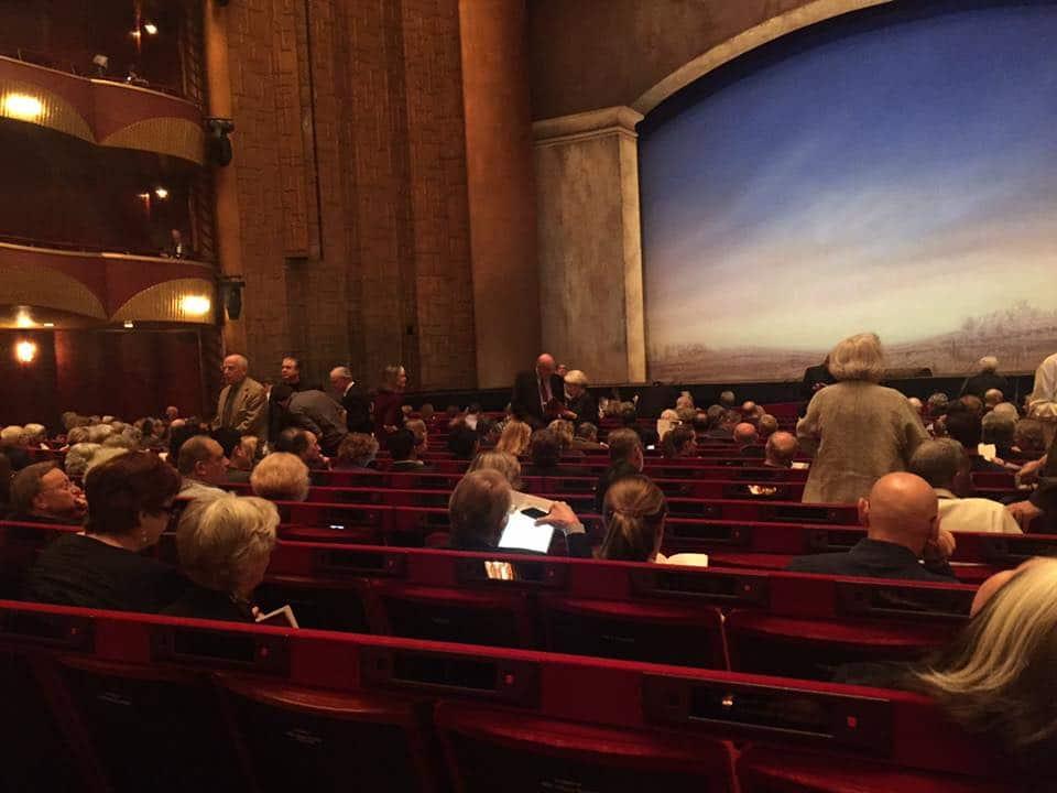 Two women watch 200 Met operas